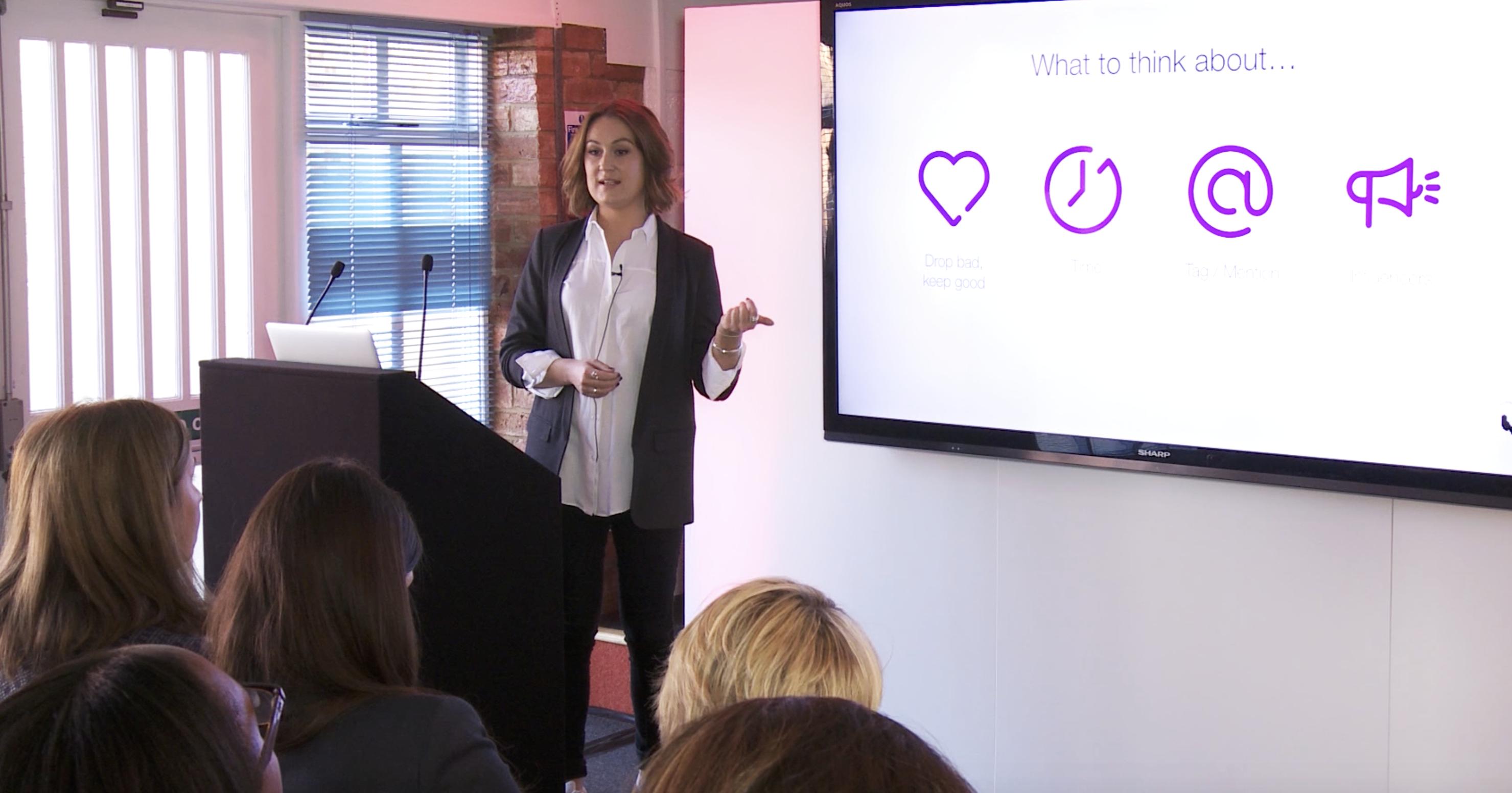 Camilla presenting at a conference