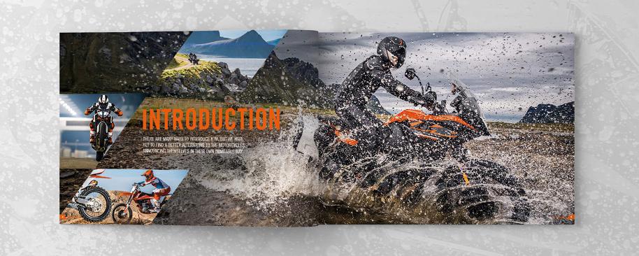 KTM printed brochure on grey splattered background