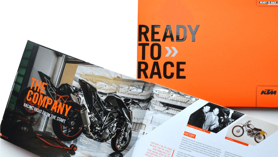 KTM printed brochure cover and spreads