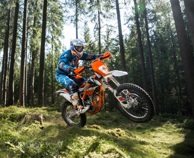 KTM motorcycle being ridden in woods