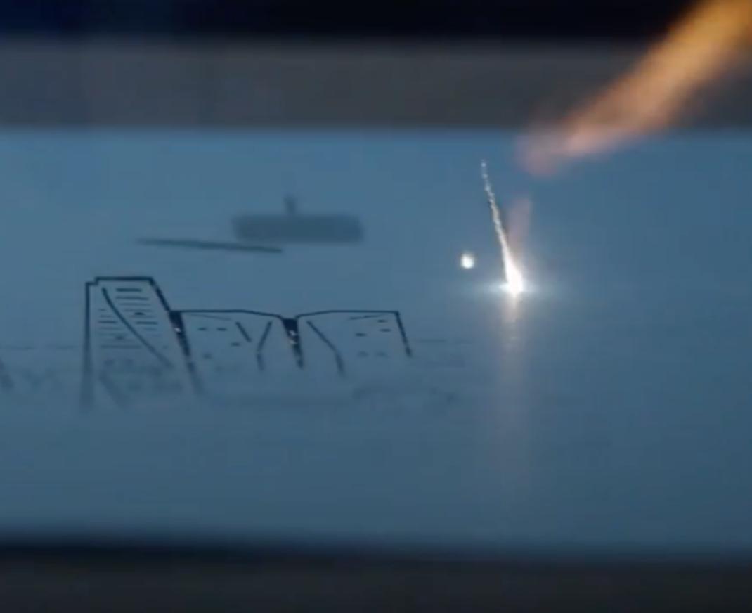 Laser cutting a city scene
