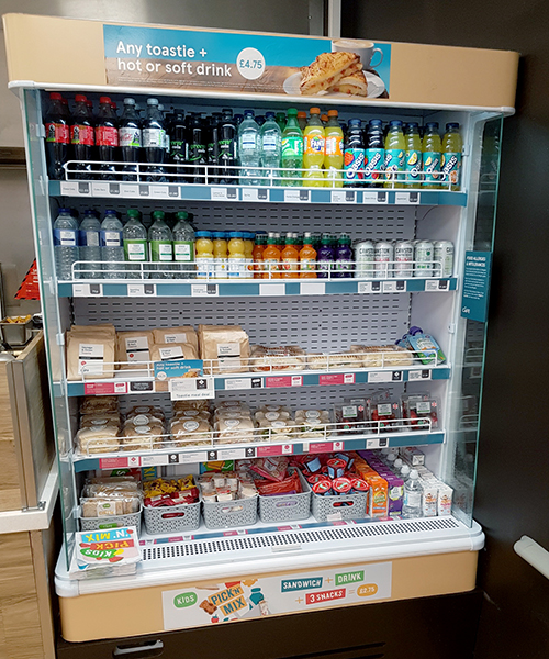 Tesco cafe chiller cabinet with printed promotional graphics