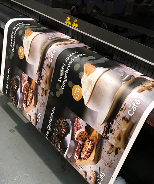 Tesco Cafe posters being printed on a inkjet printer