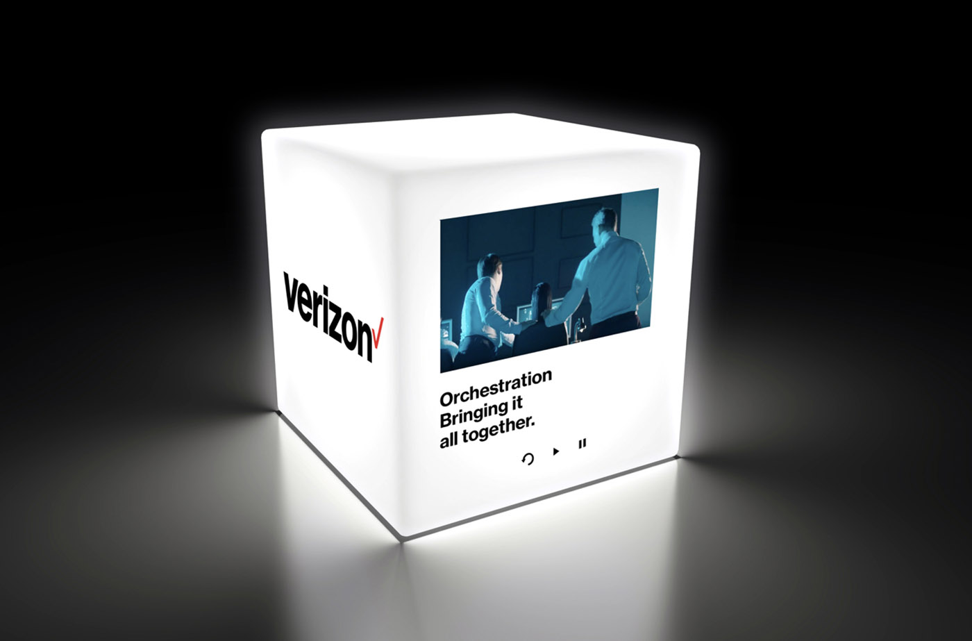 Verizon cube lit up on black background