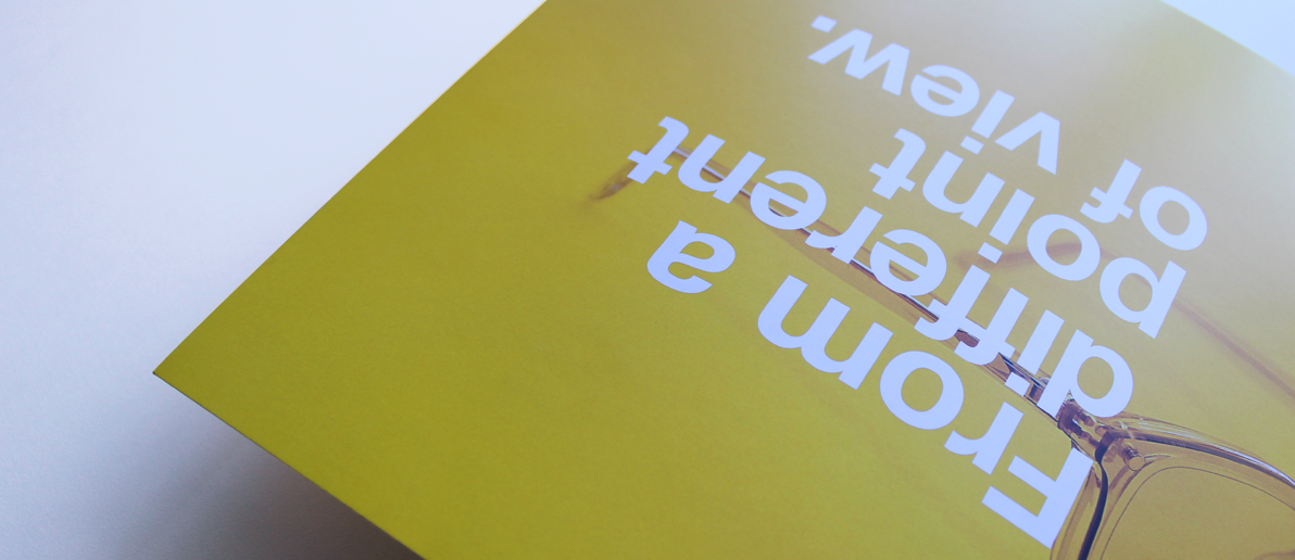 Yellow printed brochure saying from a different point of view